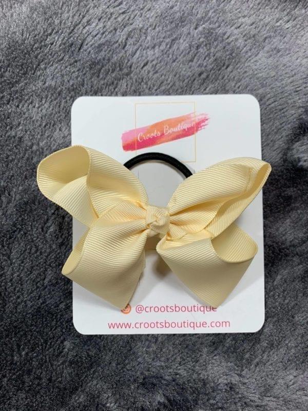 Cream bobble bow
