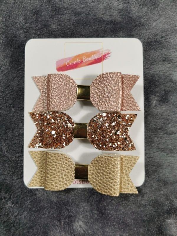 Bronze bow trio