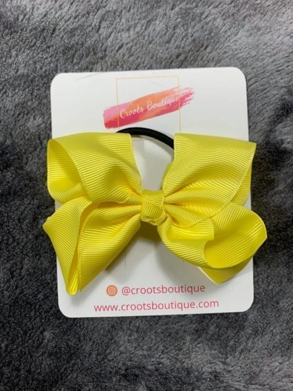 Yellow bobble bow